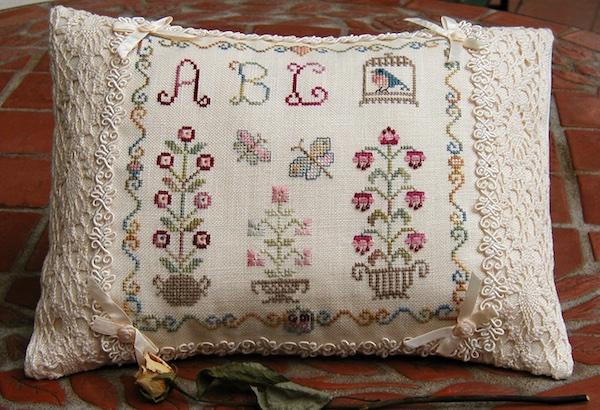 embroidered blue bird pillow
