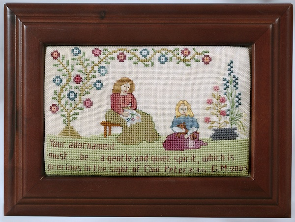 embroidered box with mom daughter and dog under a tree
