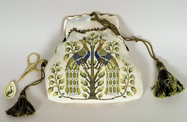 purse with embroidered green and blue peacocks with mother of pearl frame
