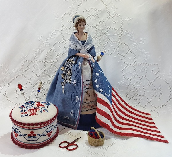 Embroidered pincushion doll representing Betsy Ross and the American Flag designed by Giulia punti Antichi