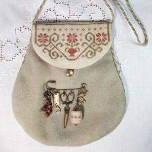 embroidered tiny purse with broach with needlework related charms