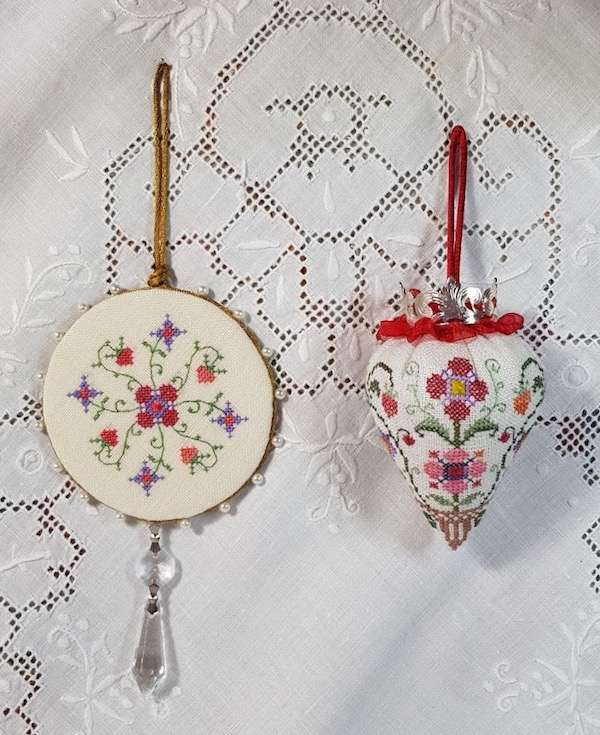 a pinkeep and a strawberry embroidered in colonial williamsburg style