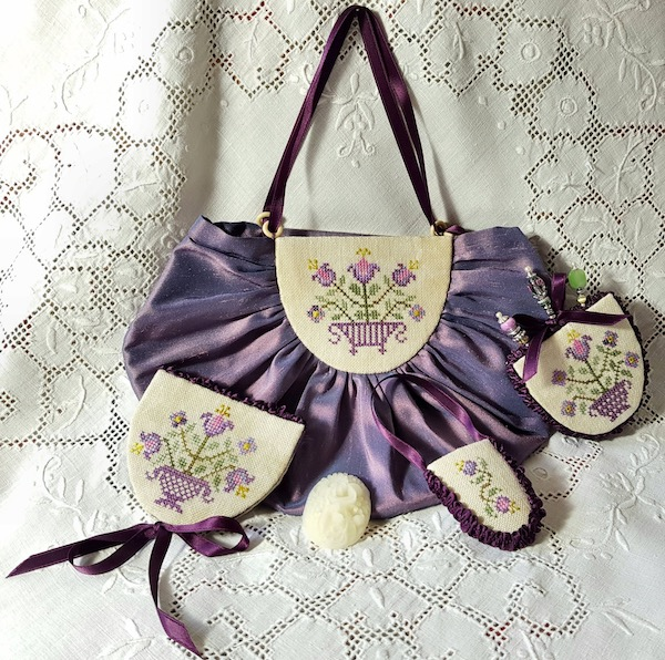 purple sewing purse with flower pots and lilies and lavanders embroidered by Giulia Punti Antichi