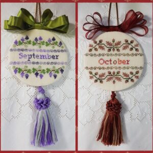 two christmas ornaments embroidered with bow and tassle for months of September and oof October in green and lilac and brown and red