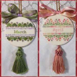 two christmas ornaments embroidered with bow and tassle for months of March and april