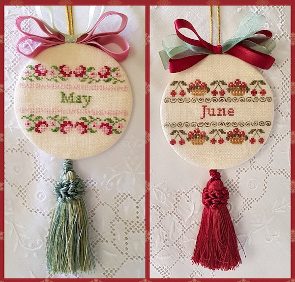 two christmas ornaments embroidered with bow and tassle for months of May and June