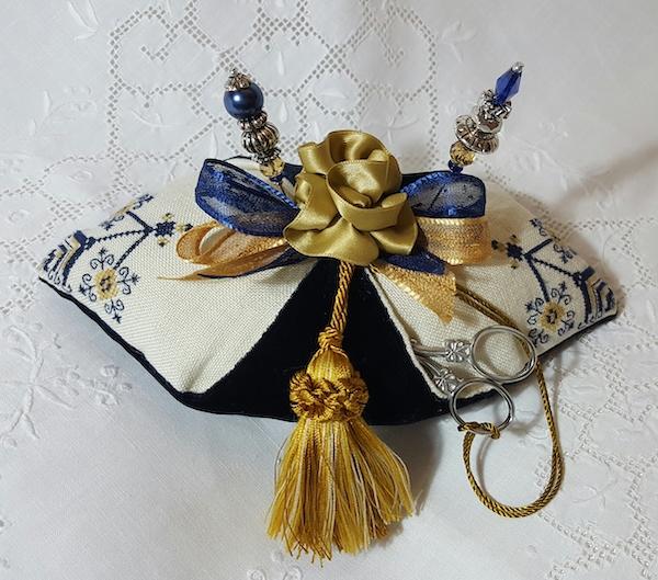 blue and gold pincushion pillow