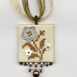 embroidered flower pendant with golden beads and mother of pearl buttons
