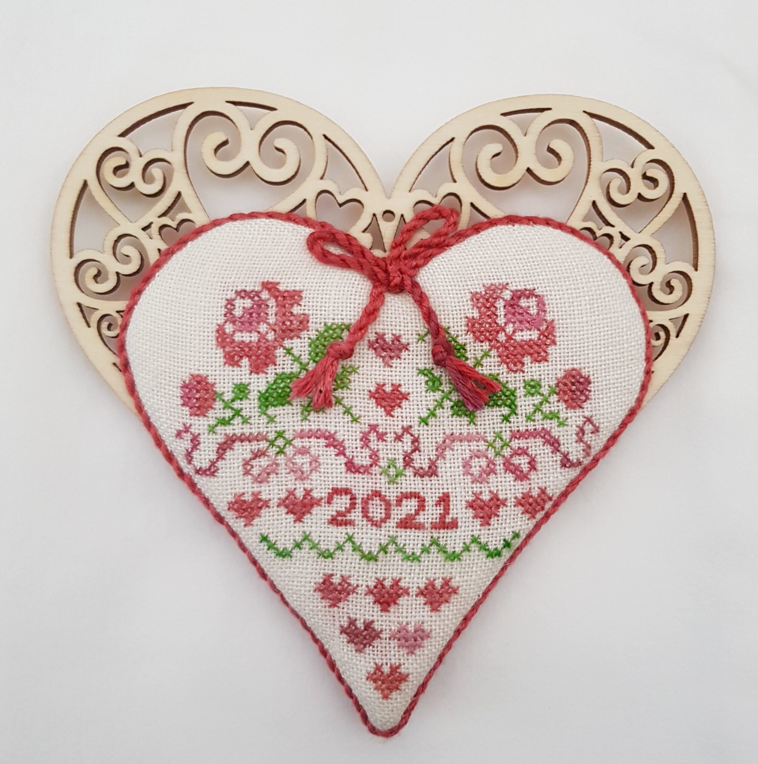 wooden heart with stitched roses one side